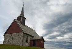 Norwaigian mystic church. Church in nroway with blue sky Royalty Free Stock Images