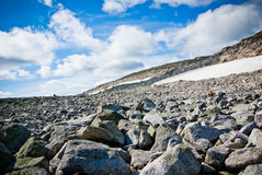 Norway. Blue sky and white clouds over rocky landscape in Norway Stock Photos