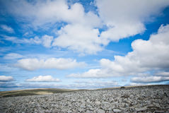 Norway. Blue sky and white clouds over rocky landscape in Norway Stock Photography