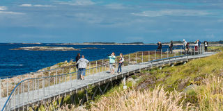 NORWAY, THE ATLANTIC ROAD - OCTOBER 2015: Tourists take pictures of each other near the Atlantic road. Royalty Free Stock Photos