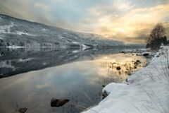 Norway, reflection at sunset stock images