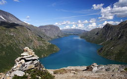 Norway: Bessegen. Cairn / Stone pile marking the famous Bessegen hiking trail in Jotunheim National Park, Norway. Gjende Lake stock photos
