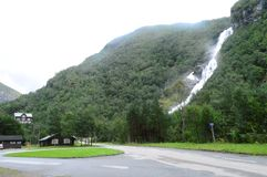 Norway. The building next to the waterfall. stock images
