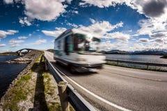 Norway. Caravan car travels on the highway. Caravan car RV travels on the highway. Caravan Car in motion blur. Norway. Atlantic Ocean Road or the Atlantic Road Stock Photo