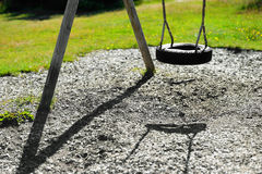 Norway children swing from tire background Stock Photos