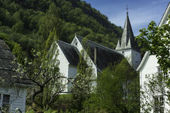 Norway City Stave Church. A small white stave chruch at the Hradanger Fjord at Norway Stock Photo