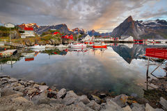 Norway coast with boat and red huts, Reine Stock Images