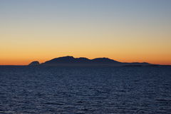 Norway coast landscape by night view 8. View of Norway coast by night or sunset  from a cruise boat Royalty Free Stock Photography