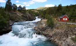 Norway - The cottage and the river Royalty Free Stock Image