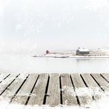 Norway Cottage on winter coast with wooden platform dock with white snow grunge Stock Image