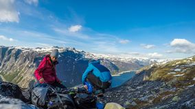 Norway - A couple having breakfast in the tall mountains with a view on a lake royalty free stock photos