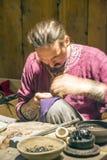 Norway Craftsman sewing Stock Images