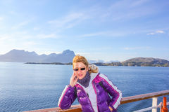 Norway cruise ship tourist. Norway cruise ship happy tourist enjoying trip to Northern Europe. Cruise on Norwegian Fjords. Caucasian woman on travel vacation Royalty Free Stock Images