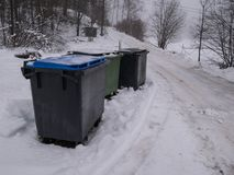 Trash can out in the winter snow stock image