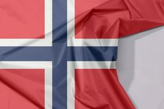 Norway fabric flag crepe and crease with white space. Norway fabric flag crepe and crease with white space, a white-fimbriated blue Nordic cross on a red field stock photos