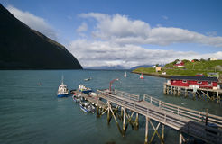 Norway fishing port. A small Norwegian fishing port with a single jetty and boats moored. Koppangen, northern Norway Stock Image