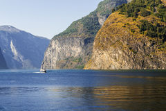 Norway fjord landscape. With a little ship Royalty Free Stock Image