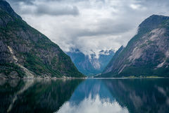 Norway fjord scenic landscape of Eidfjord with mountain reflections on the water. Stock Photos