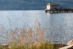 Norway fjord shore. And a pier with small house Royalty Free Stock Photography