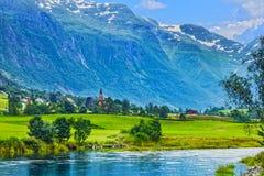 Norway fjord, Sunset mountain village Olden. Stock Photos