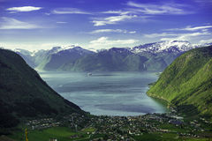 Norway Fjord Valley. A beautiful valley in the north of Norway, with a ferry that leaves the port Royalty Free Stock Photo