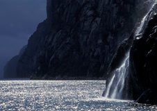 Norway - fjord with waterfall in the back light Stock Photo