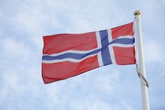 Norway flag. Of on blue sky background Royalty Free Stock Photo