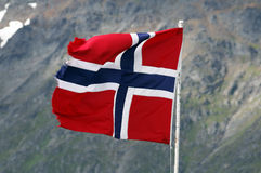 Norway flag. Waving in front of mountain background stock photography