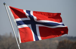Norway flag. With blue sky as background stock image