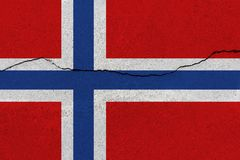 Norway flag on concrete wall with crack. Patriotic grunge background. National flag of Norway stock images
