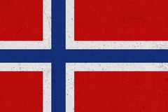 Norway flag on concrete wall. Patriotic grunge background. National flag of Norway royalty free stock photo