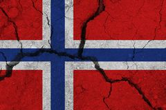 Norway flag on the cracked earth. National flag of Norway. Earthquake or drought concept royalty free stock photos