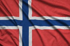 Norway flag is depicted on a sports cloth fabric with many folds. Sport team banner. Norway flag is depicted on a sports cloth fabric with many folds. Sport team stock photo