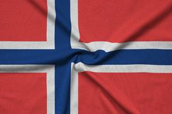 Norway flag is depicted on a sports cloth fabric with many folds. Sport team banner. Norway flag is depicted on a sports cloth fabric with many folds. Sport team vector illustration
