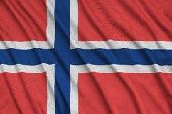 Norway flag is depicted on a sports cloth fabric with many folds. Sport team banner. Norway flag is depicted on a sports cloth fabric with many folds. Sport team royalty free stock photography