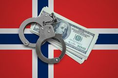 Norway flag with handcuffs and a bundle of dollars. Currency corruption in the country. Financial crimes.  royalty free stock photography