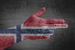 Norway flag painted on male hand like a gun. Isolated royalty free stock photos