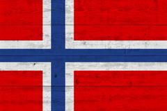 Norway flag painted on old wood plank. Patriotic background. National flag of Norway royalty free stock photography