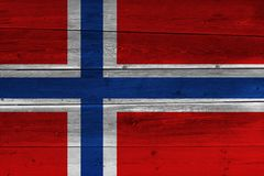 Norway flag painted on old wood plank. Patriotic background. National flag of Norway stock images
