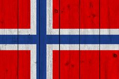 Norway flag painted on old wood plank. Patriotic background. National flag of Norway stock image