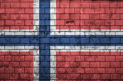 Norway flag is painted onto an old brick wall stock illustration
