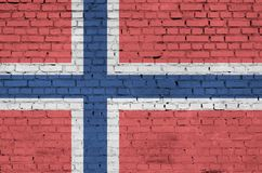 Norway flag is painted onto an old brick wall stock image