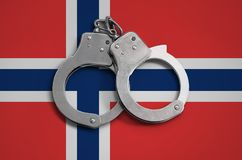 Norway flag and police handcuffs. The concept of observance of the law in the country and protection from crime.  stock photos