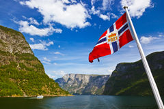 Norway flag and Sognefjord. Nature and travel background stock photography