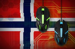 Norway flag and two mice with backlight. Online cooperative games. Cyber sport team. Norway flag and two modern computer mice with backlight. The concept of royalty free stock photography