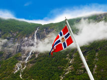 Norway flag and waterfall. Nature and travel background stock photography