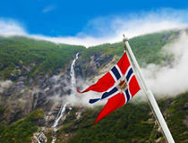 Norway flag and waterfall. Nature and travel background stock photos