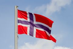 Norway flag. Is waving in front of blue sky royalty free stock photography