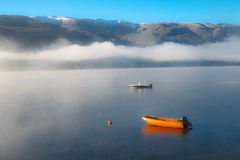 Norway foggy view of lake Stock Image