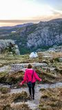 Norway - A girl going down the trail to the tent stock images